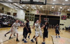 Varsity basketball shoots past SLUH in final minutes
