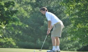 Golf swinging away