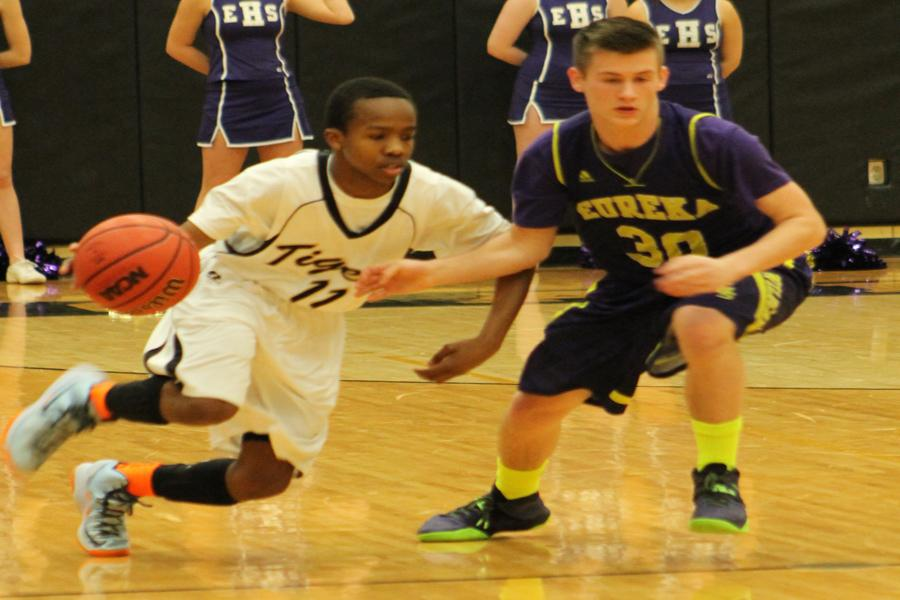 Marquis Pepper (11) brings the ball up the court in a game against Eureka earlier this season.
