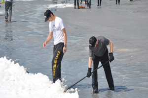 Boys shovel off the baseball field last spring break after a snow storm late last March.