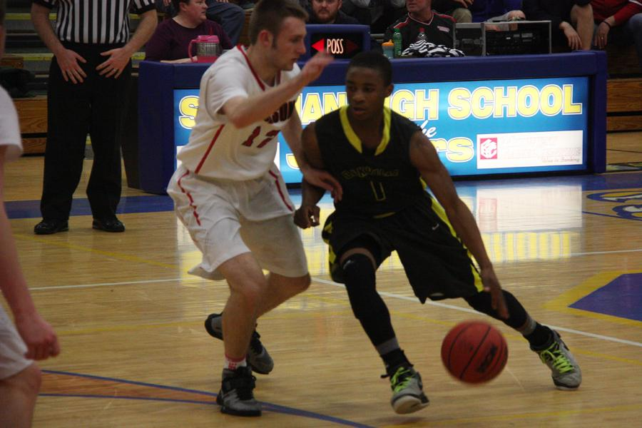 Carvon Robinson (11) drives the lane in the Tigers game against Jackson.