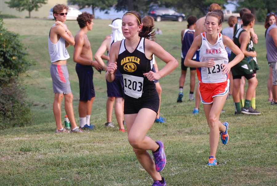 Bridget Costello (9) finished first for the OHS girls cross country team at the team's first meet on Friday, Sept. 5. Costello finished 22nd out of 119 runners.