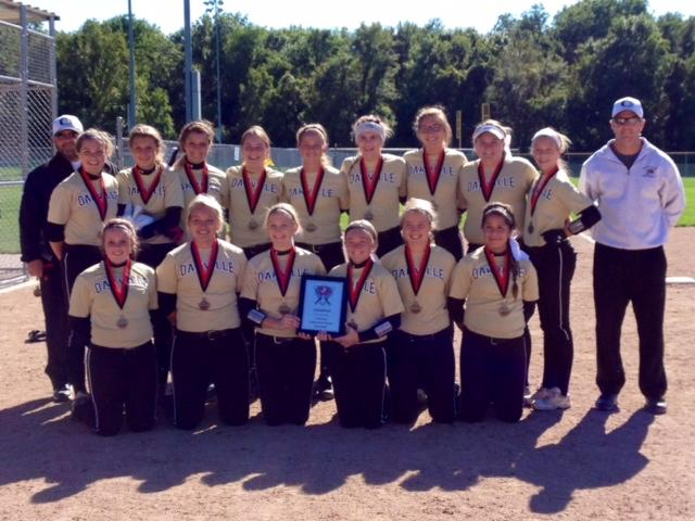 The varsity softball players stand with their medals after winning the Jefferson City tournament. The team is now  12-1.