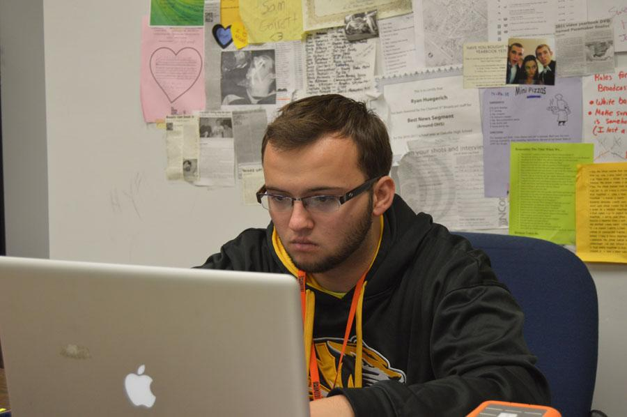Line Producer Jake King (12) focuses on editing a Channel 97 Broadcast.