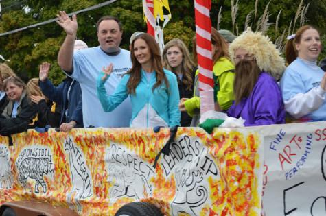 Teachers gather in their own float and wave to the crowd.