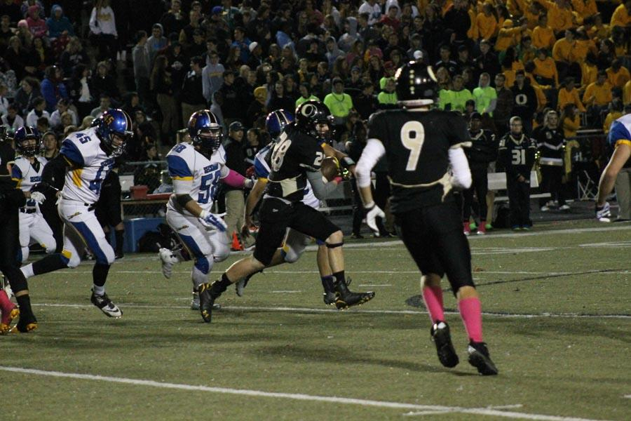 Connor Bartow (10) runs for a 73-yard touchdown against Seckman on Oct. 3. OHS beat Seckman 55-14.