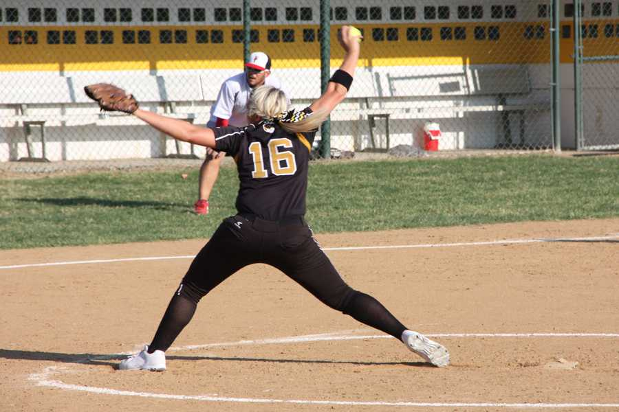 Alex Frenz (12) pitches in the district varsity softball game against Cor Jesu on Oct. 11. Frenz is first in the area with a 0.58 earned run average (ERA) over 132.3 innings.