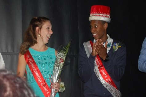 "Seniors Sophie Seim and Joe Green smile to each other as they are announced the King and Queen of the ""Big Top."""