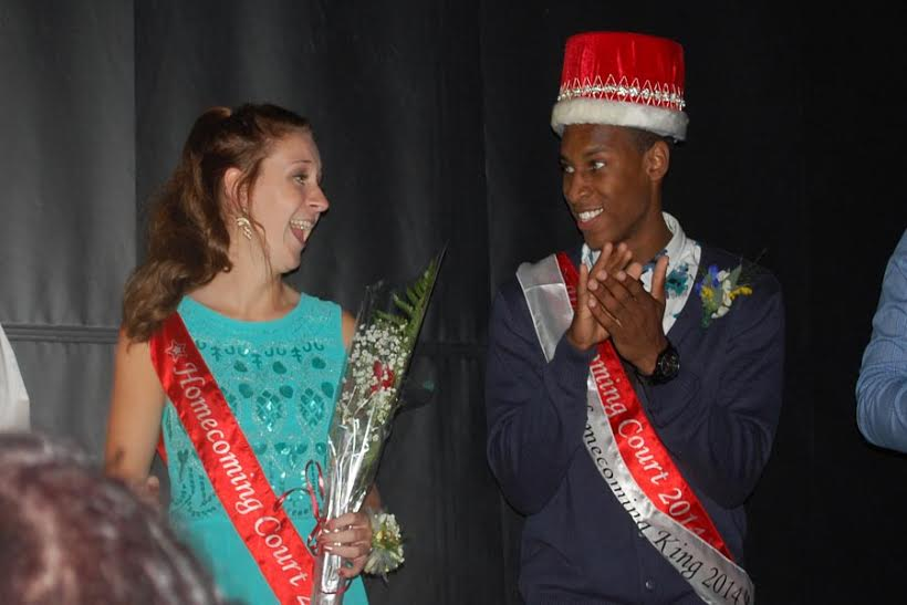 Seniors+Sophie+Seim+and+Joe+Green+smile+to+each+other+as+they+are+announced+the+King+and+Queen+of+the+%22Big+Top.%22
