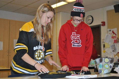 Rebecca Haegele (12) and Jessica Leeker (11) work on the t-shirt quilt.