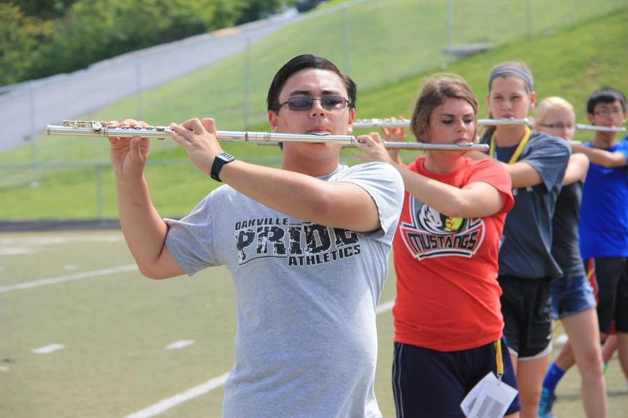 Donald Rabin (12) practices the flute during marching band practice. Rabin was chosen for the MMEA First-Chair Flute in the 2014-2015 school year.