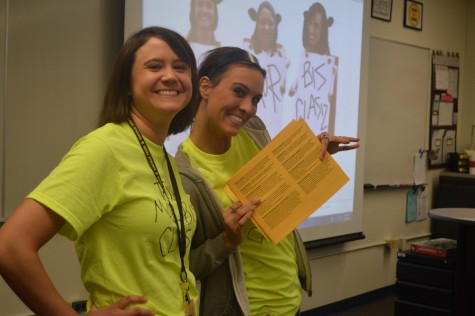 Mrs. Katie Kasper (left) and Mrs. Kori Vagner (right) smile as they promote the business department on Elective Preview Day.