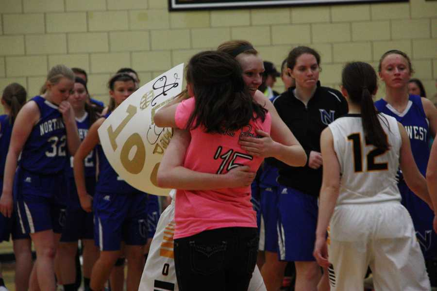 Norberg (12) hugs Amber Gerheart (12) after the game. Norberg finished the season with an average of 14 points per game.