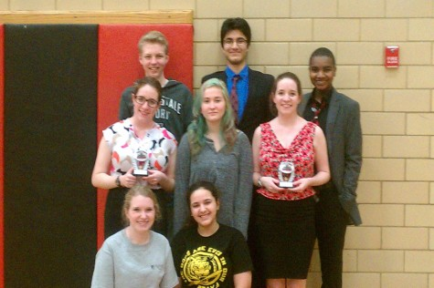 The Speech and Debate team poses for a victory photo.