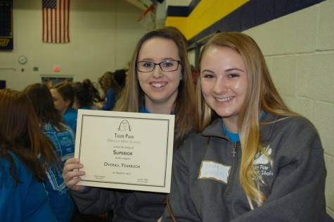 "Tiger Paw Editor-in-Chiefs Alexa Shelton (12) and Ashley Arconati (12) smile as they receive a ""Superior"" rating at the annual SSP Journalism Conference."