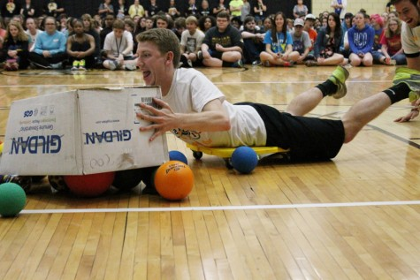 "Colin Moran (12), a Mr. OHS  contestant, tries to collect as many balls as he can while he plays human ""hungry hippos."""