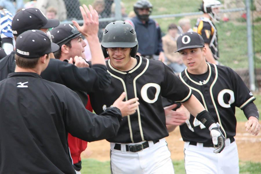 Matt+Miller+%2811%29+celebrates+after+hitting+a+solo+home+run+in+the+varsity+baseball+team%27s+tournament+championship+game+against+Vianney+on+March+25.+OHS+won+5-4.