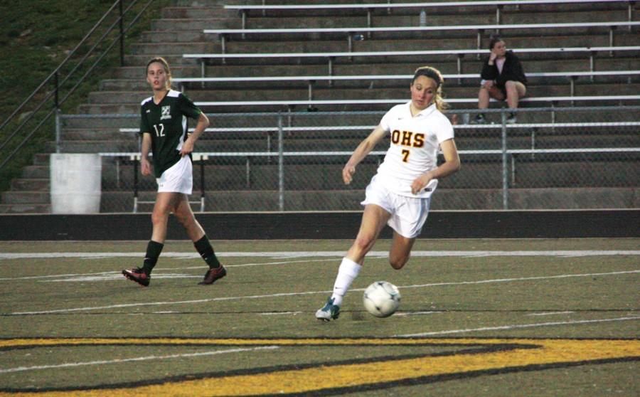Ashley Guardado (9) dribbles toward the goal in the Tigers' 1-0 win over Mehlville on April 16. Guardado is the team's leading scorer with five goals.