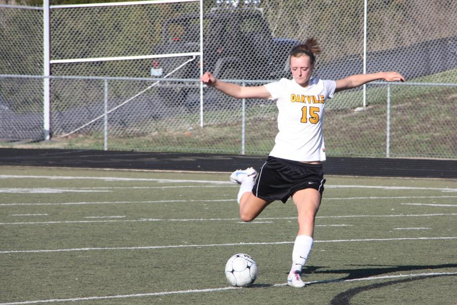 Alyssa Norberg (12) takes a free kick in the Tigers' 1-0 win against Kirkwood on March 31. Norberg scored her first career goal on senior night.