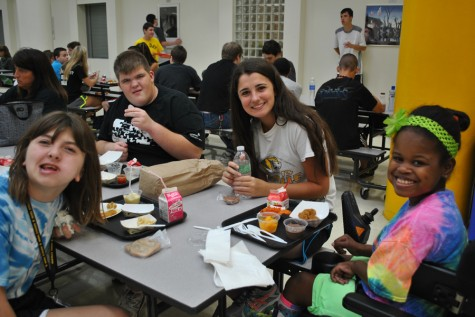 Friendships form as Leadership and SSD students eat lunch together.