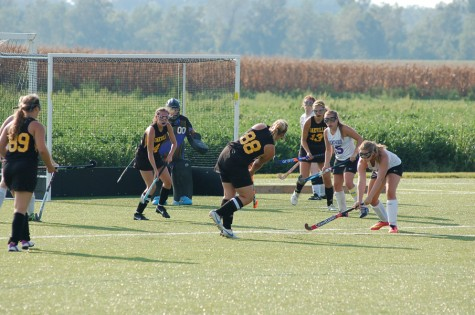 Lydia Flieg (11) takes a shot during a game against Brentwood. The tigers won the game 5-0.