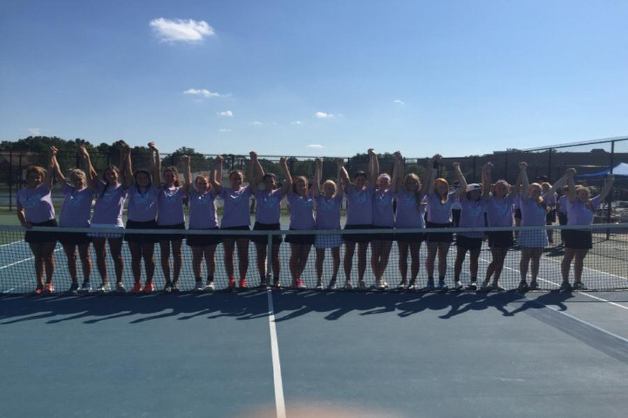 The 2015 girls tennis team poses just before their match. Photo courtesy of Rachel Kendrick.