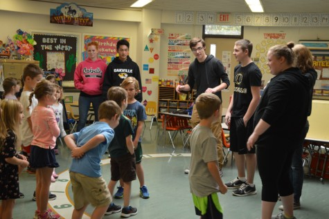 Drama students interact with the subjects of their study.
