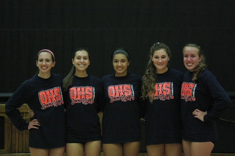 Varsity+volleyball+seniors+pose+for+a+picture+before+their+game+against+Mehlville.