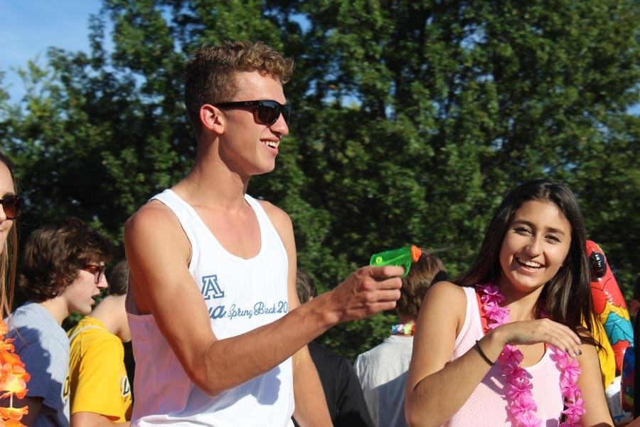 Griffin Bailey (12) shoots Paige Pommer (10) with a water gun during the annual Homecoming Parade.