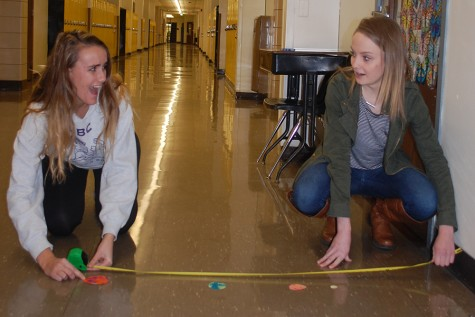 Students measure the distance between two planets.