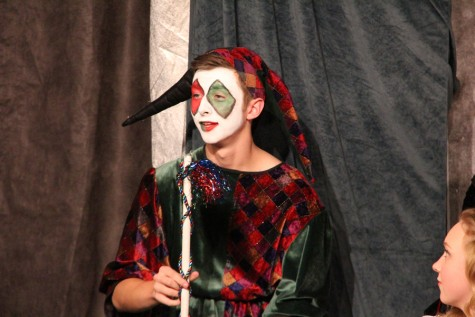 Alec Boeschen plays the part of the Jester.