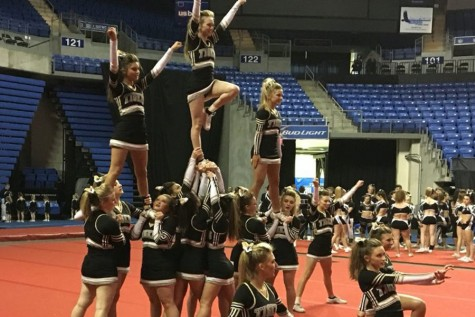 Varsity cheerleaders jam towards first competition