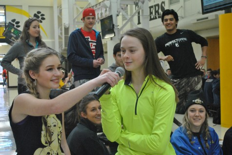 A student steps up to the mic on Hip Hop Day.