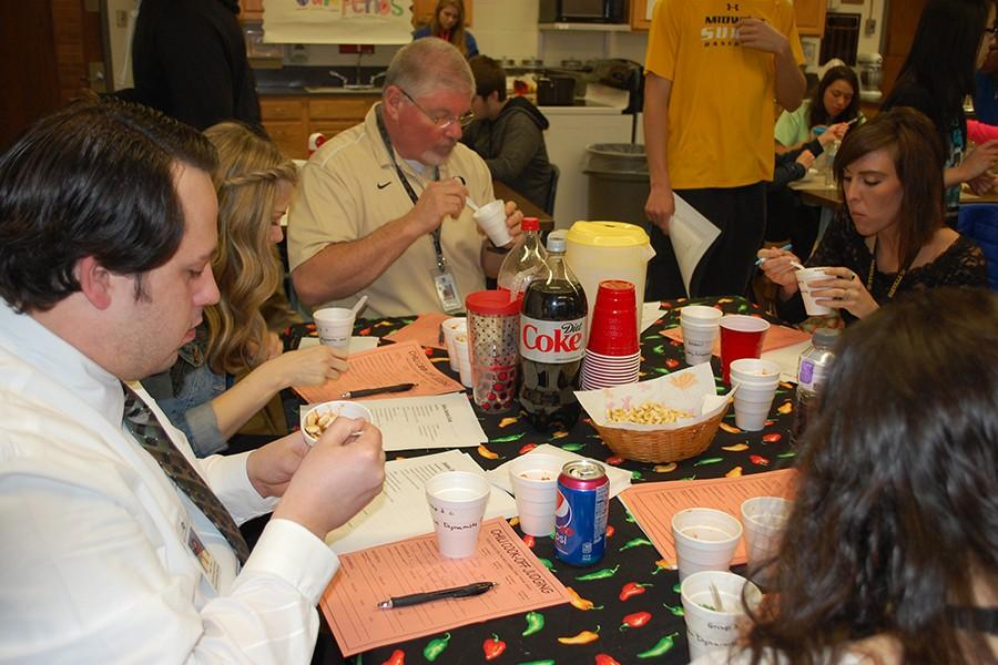 Several judges try out students' creations.