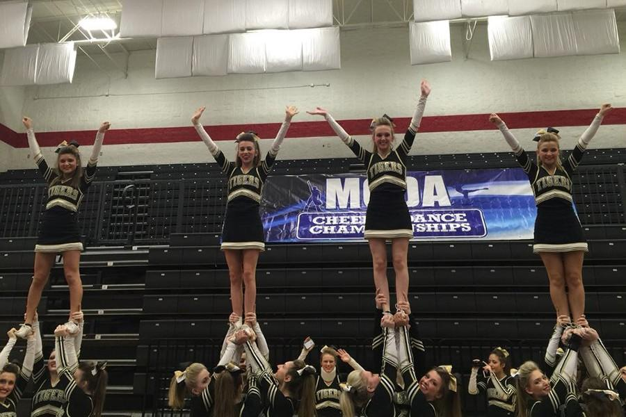 OHS cheerleaders wave to the crowd at MCDA.