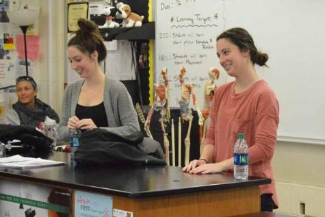 Jenna and Blair Lamatina speak to students at a HOSA meeting.