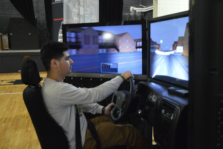 A student tries out the drunk driving simulator.