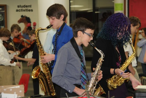 Several saxophone players from OHS warm up before their performance at district solo & ensemble.