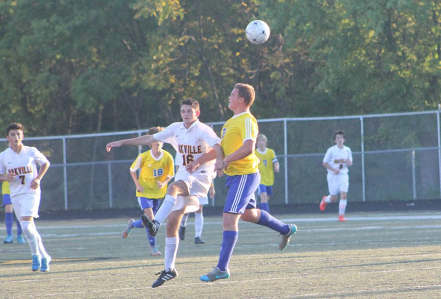 Garrett Balassi (12) chases after the ball in a game against Seckman on Sept. 6.