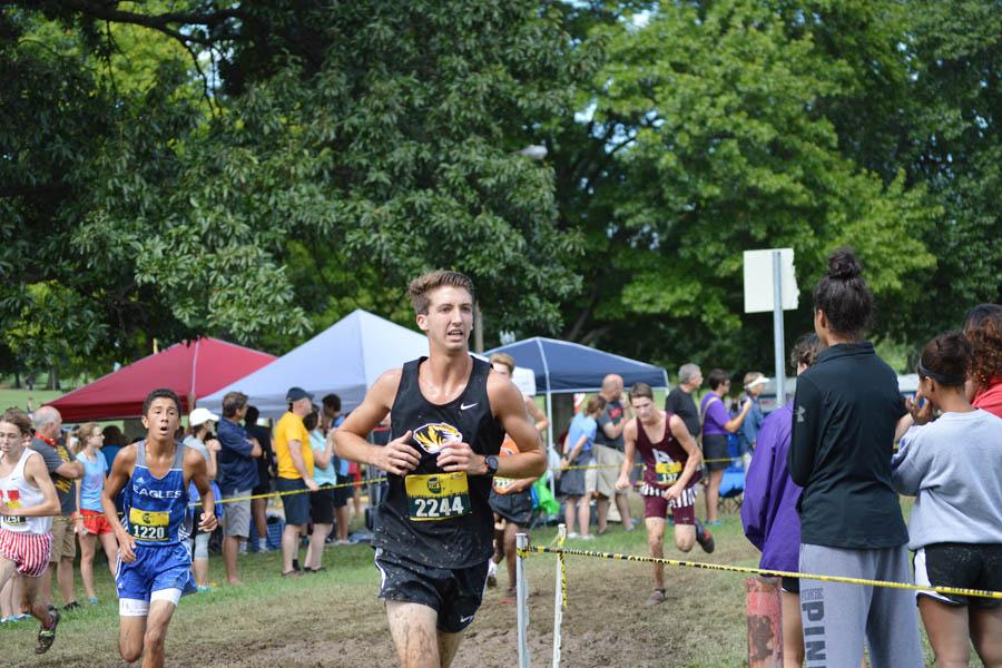 Nick Durham (12) races towards the finish line during the Cross Country Festival in Forest Park on Sept. 10.