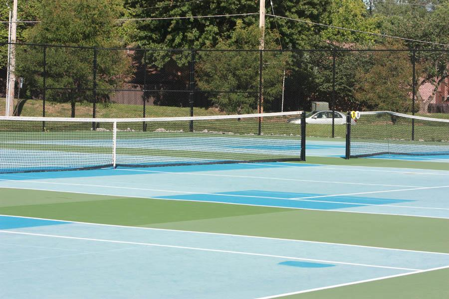 The Oakville tennis team's home courts, located at Bernard Middle School, under construction and half painted right before the girl's senior night matches.