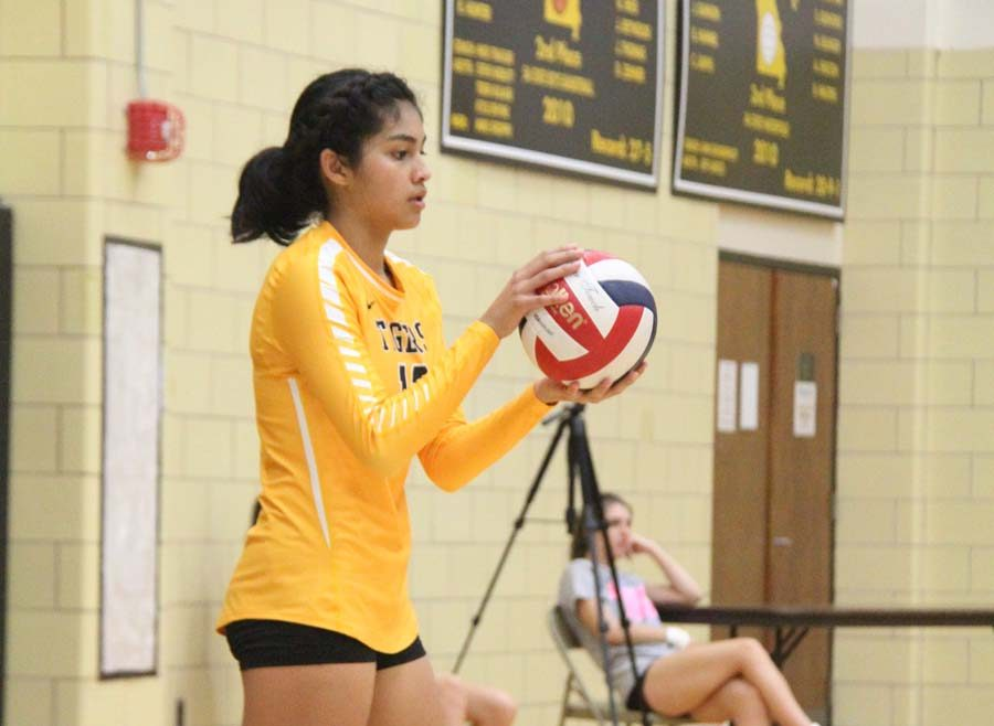 Angela Elguezabal (9) prepares to serve the ball at a home game.