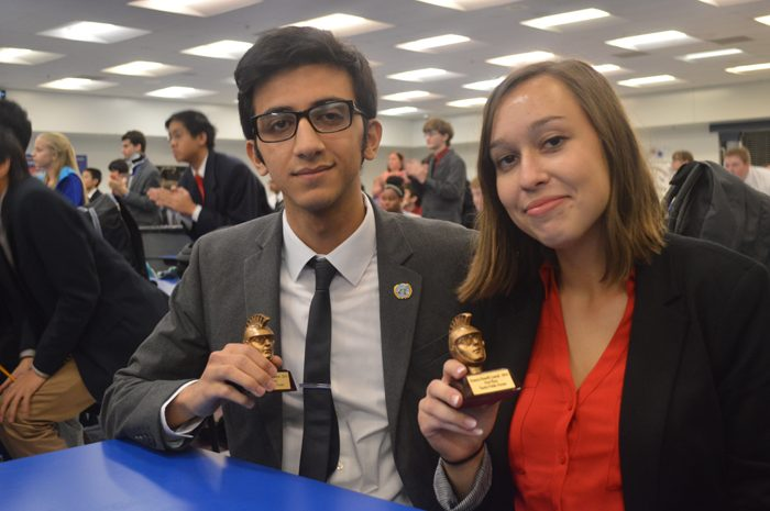 Sohrab Azad (12) and Brooke Mumma (12) pose with their first place trophies. This was their second tournament of the season and the first they competed in together.
