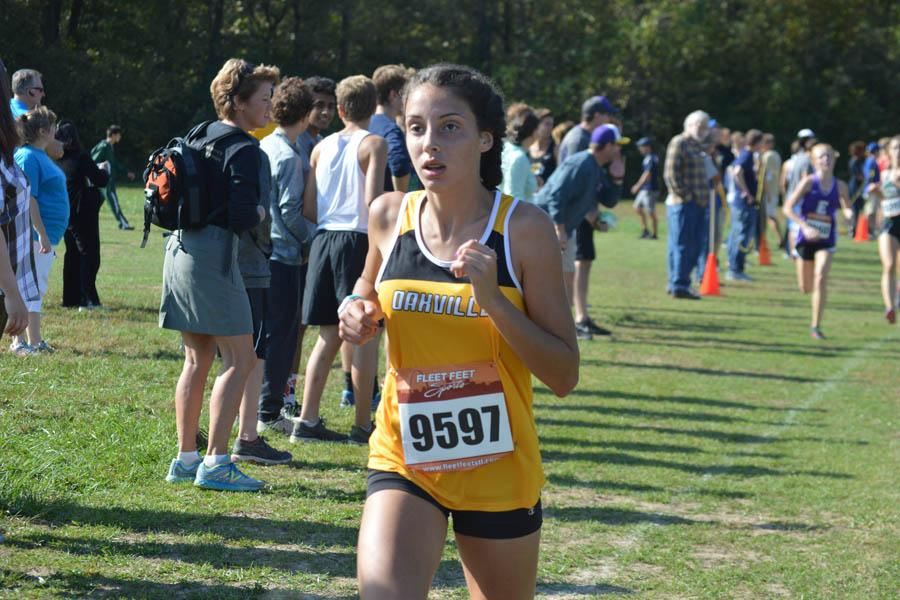Halle Ezell (9) focuses on the finish at the Northwest meet on Oct. 15.