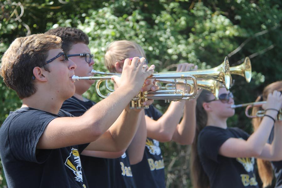 Conrad Bucholtz (11) plays the trumpet at Super Saturday on Sept. 10.