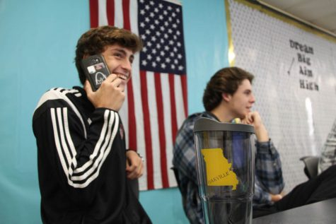 Collin Neff (12) shows off the cash case and Tiger Tumblers being sold by Mrs. Amelia Darbys Entrepreneurship classes.