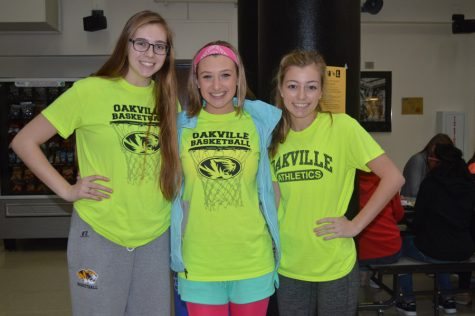 Taylor Zarr (11), Hannah Baker (11), and Caroline Roah (11) dress up in their neon wear in preparation for the winter pep assembly and the Dance for Charity.