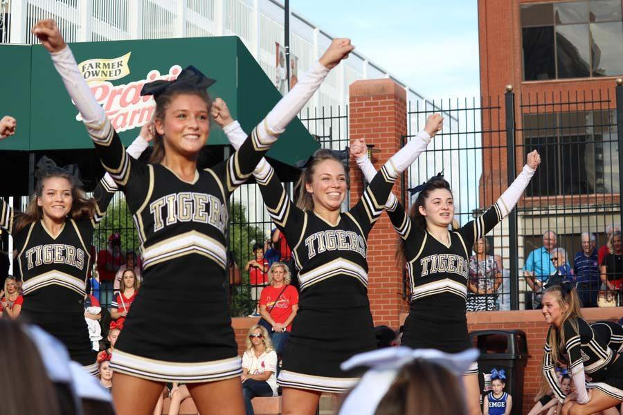 Varsity cheer showed off their skills at a Cardinals game where they sold tickets to raise money for St. Jude.