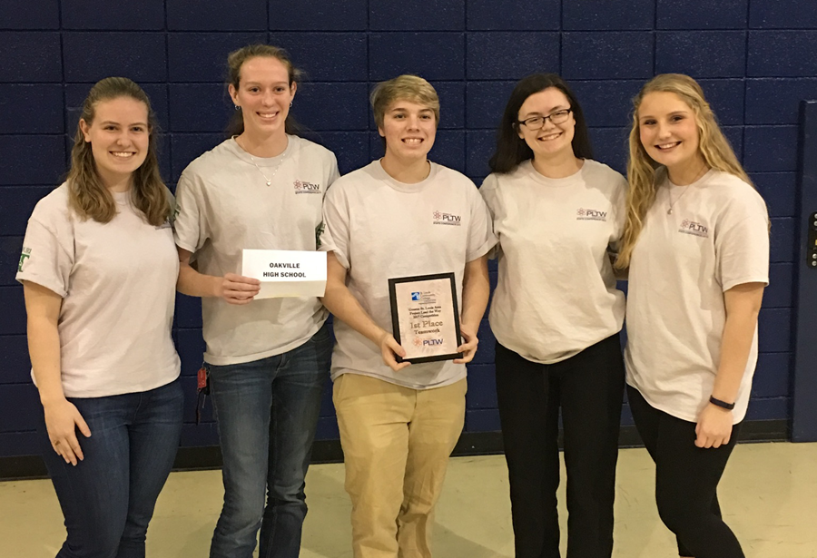 Project Lead the Way (PLTW) students stand with their first place award.