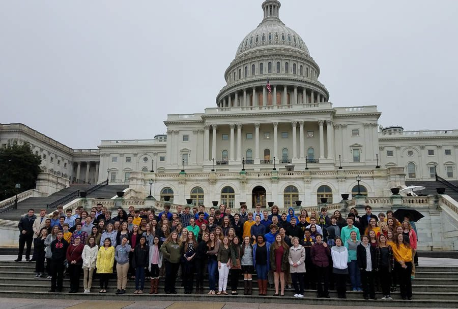 The band gathers together in front of the U.S. Capital Building to take a picture before their tours.